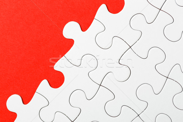 Incomplete puzzle in red color Stock photo © leungchopan
