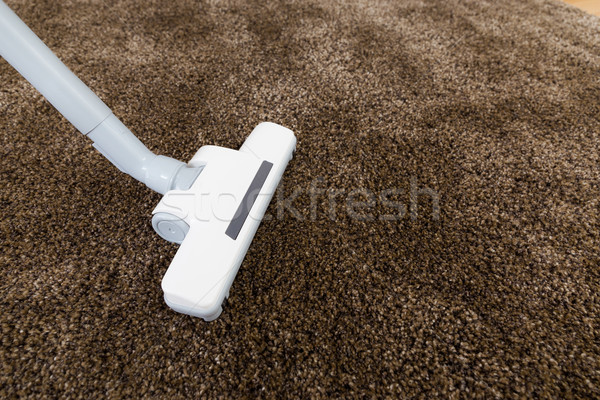 Stock Photo: Brown Carpet With Vacuum Cleaner In Living Room