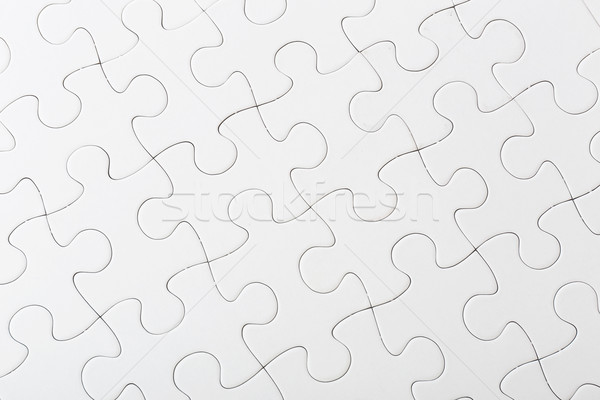 Completed white puzzle Stock photo © leungchopan
