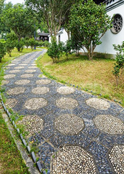Caillou pierre chemin chinois jardin arbre Photo stock © leungchopan