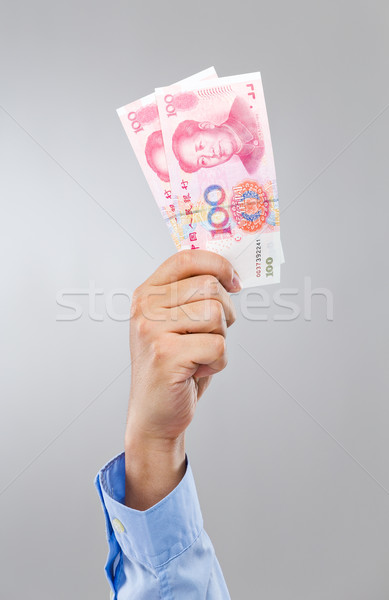 Businessman hold with chinese yuan Stock photo © leungchopan