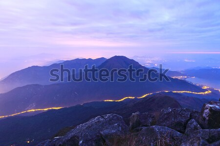 Stock photo: mountain at night with road