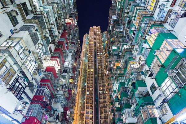 Overpopulated building in Hong Kong  Stock photo © leungchopan