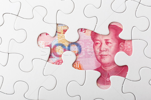 Incomplete puzzle over chinese yuan banknote background Stock photo © leungchopan