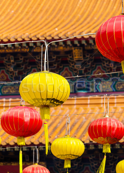 Piros citromsárga lámpás kínai templom háttér Stock fotó © leungchopan