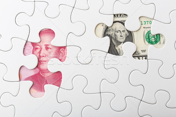 US and chinese yuan with white puzzle for exchange rate concept Stock photo © leungchopan