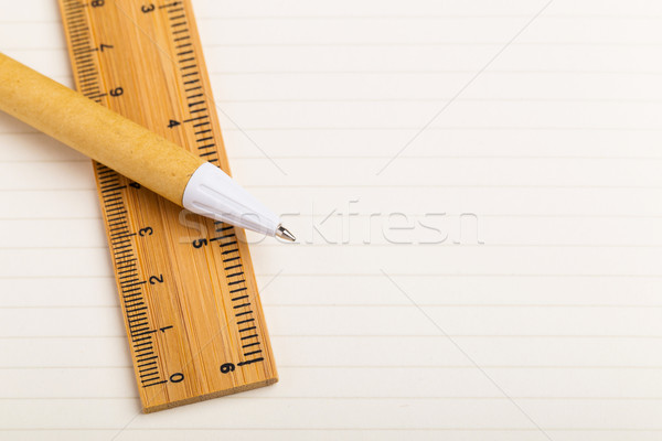 Pen and ruler on the single line paper Stock photo © leungchopan