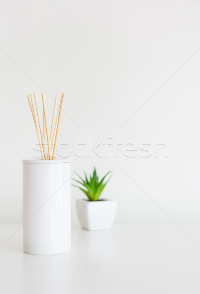 Home diffuser and small green plant Stock photo © leungchopan