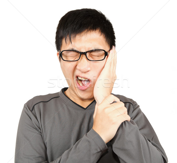 Man with pain expression on white Stock photo © leungchopan