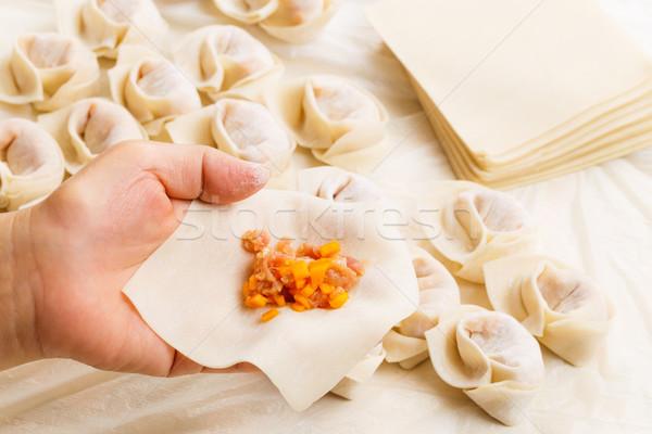 Wrapping of Chinese dumpling Stock photo © leungchopan