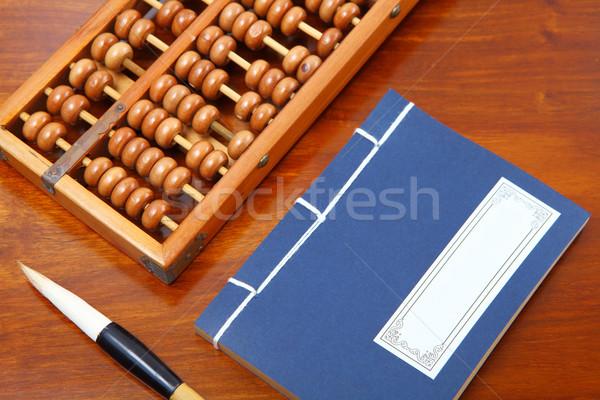 Kínai könyv abakusz ír ecset fa Stock fotó © leungchopan