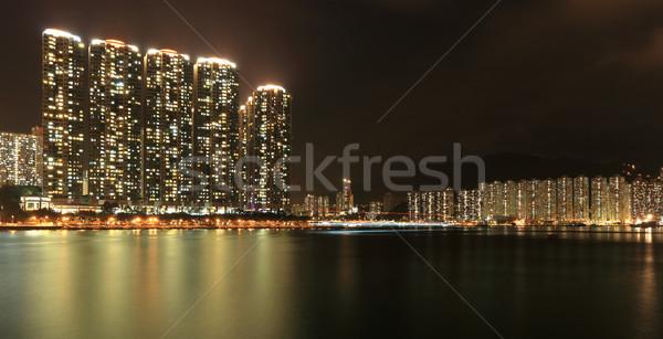 Lakás épületek Hongkong éjszaka égbolt város Stock fotó © leungchopan