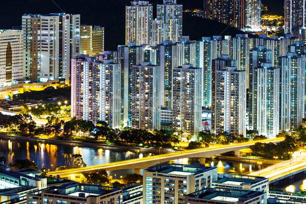 Bőséges városkép éjszaka üzlet város építkezés Stock fotó © leungchopan