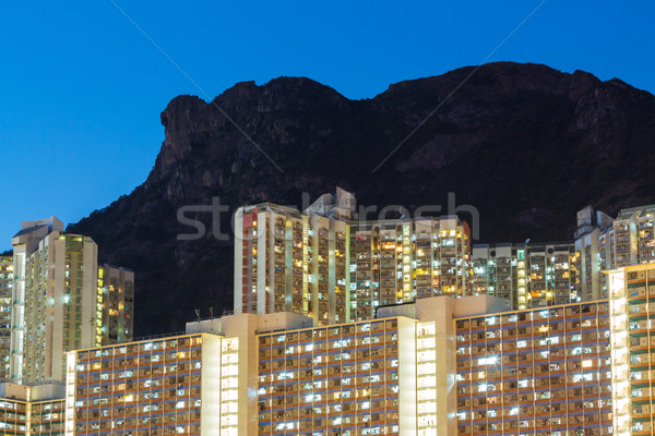 Public housing with lion rock mountain Stock photo © leungchopan