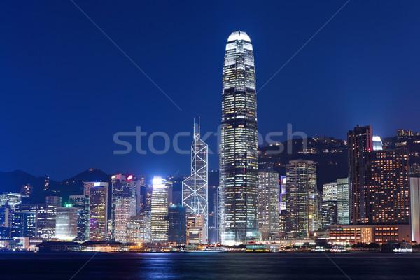 Hongkong sziluett éjszaka üzlet iroda épület Stock fotó © leungchopan