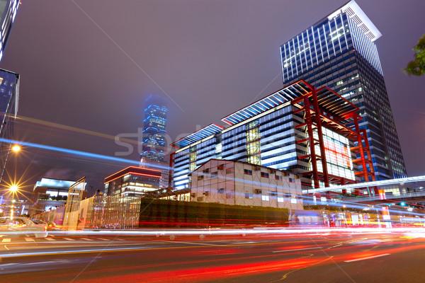 Kereskedelmi kerület éjszaka autó fény utca Stock fotó © leungchopan