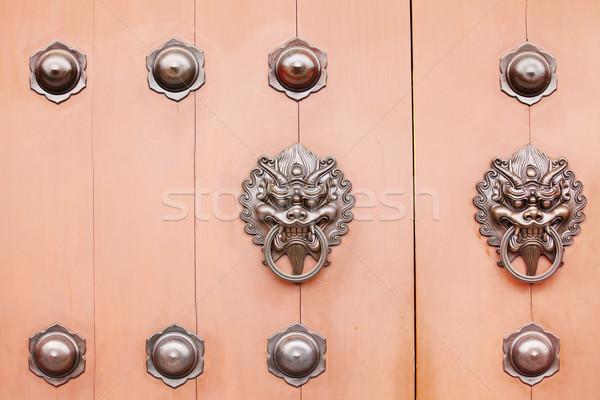 Chinese lion door knob Stock photo © leungchopan