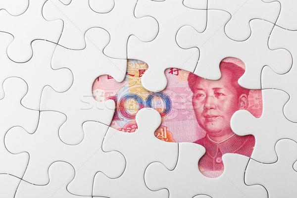 Chinese yuan and puzzle piece Stock photo © leungchopan