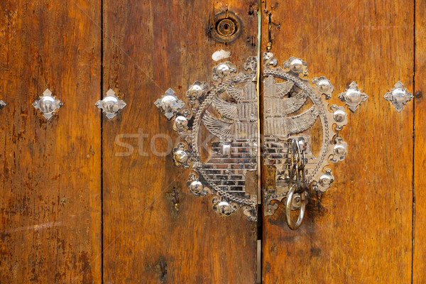 Metallic door knob with wooden door Stock photo © leungchopan
