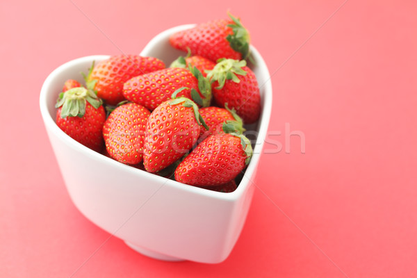 Strawberries with love Stock photo © leungchopan
