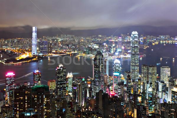 Hongkong zsúfolt épület éjszaka üzlet égbolt Stock fotó © leungchopan