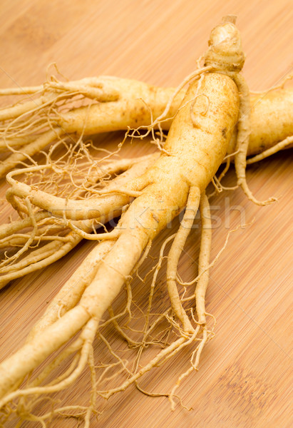 Fresh Ginseng on the wooden background Stock photo © leungchopan