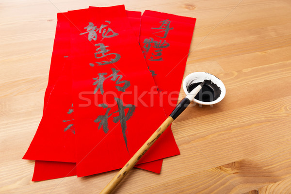 Writing of lunar new year calligraphy, phrase meaning is blessin Stock photo © leungchopan