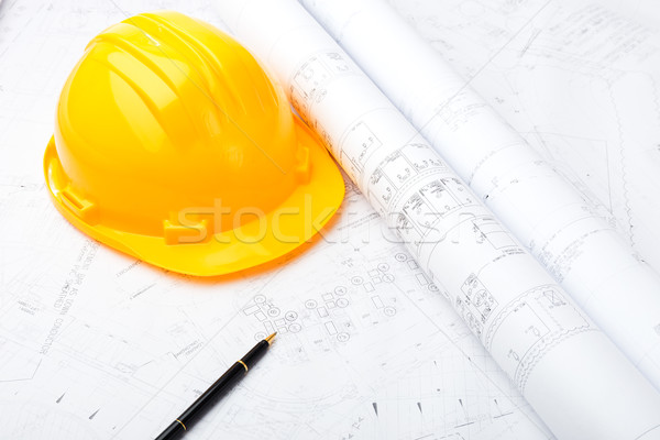 Construction drawing and safety helmet Stock photo © leungchopan