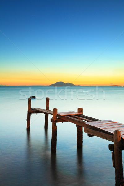 Paesaggio marino tramonto legno ponte spiaggia legno Foto d'archivio © leungchopan