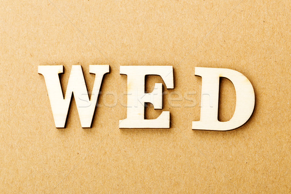 Wooden text for wednesday Stock photo © leungchopan