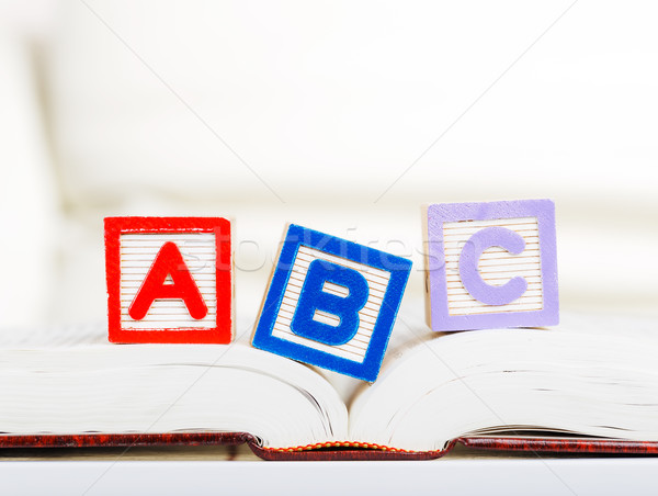 Alphabet block with ABC on book Stock photo © leungchopan