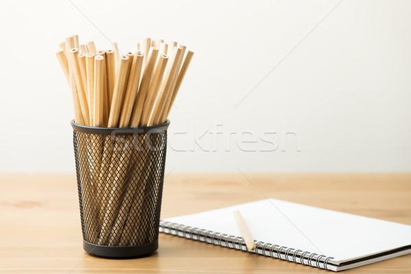 Pencil and notebook  Stock photo © leungchopan