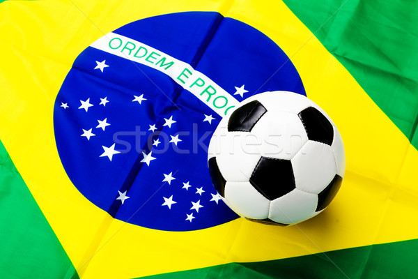Waved Brazilian flag and football Stock photo © leungchopan