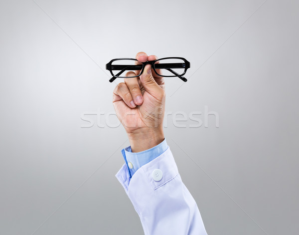 Optician doctor hold with eye glasses Stock photo © leungchopan