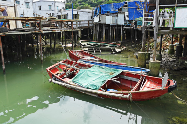 Tai O fishing village with stilt house and old boat Stock photo © leungchopan