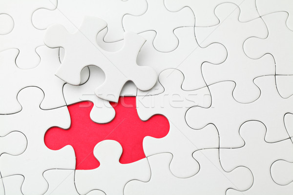 Puzzle with missing piece in red color Stock photo © leungchopan