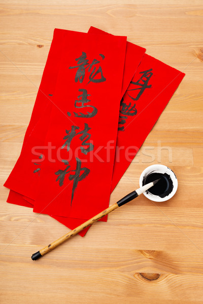 Writing of Chinese new year calligraphy, phrase meaning is bless Stock photo © leungchopan