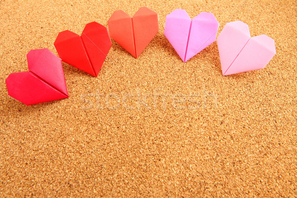 Origami colorful heart on corkboard Stock photo © leungchopan