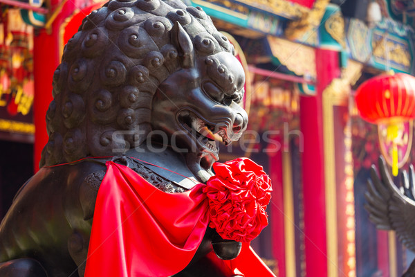 Lion rock stone in Chinese temple Stock photo © leungchopan