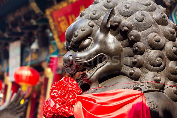 Chinês leão pedra escultura viajar nascer do sol Foto stock © leungchopan