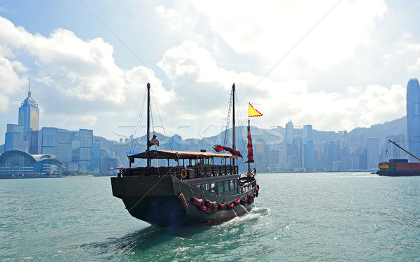 Stock photo: Hong Kong harbour with tourist junk