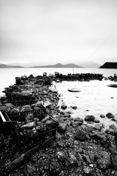 some wasted stuffs at the coastline, black and white Stock photo © leungchopan