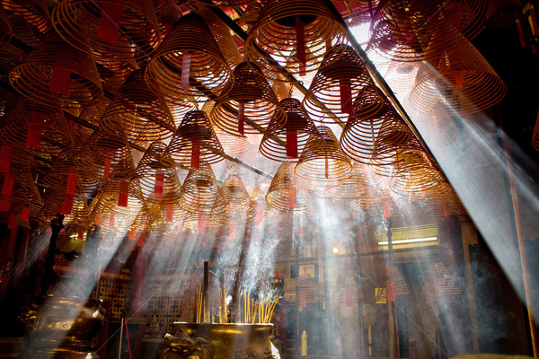 Incense and crepuscular rays in Man mo temple Stock photo © leungchopan