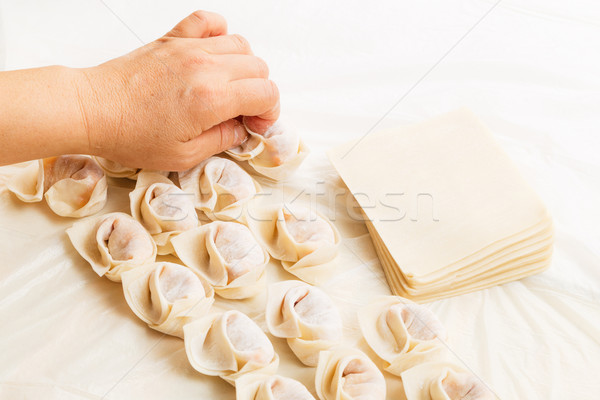 Homemade dumpling with human hand Stock photo © leungchopan