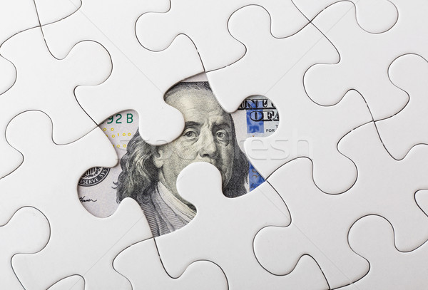 White puzzle with American dollar Stock photo © leungchopan
