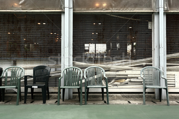 some old chairs in sport court Stock photo © leungchopan