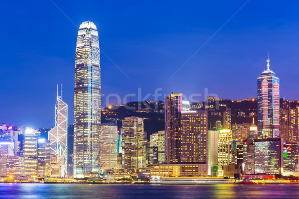 Hong Kong city skyline at night with Victoria Harbor and skyscra Stock photo © leungchopan