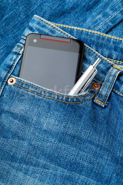 Jeans zak telefoon pen textuur mode Stockfoto © leungchopan