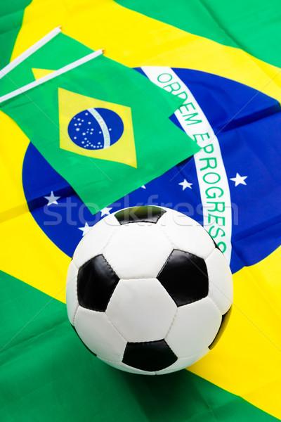 Brazilian flag and football Stock photo © leungchopan