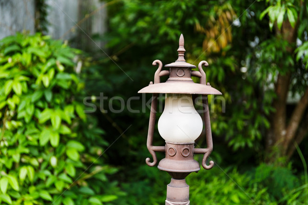 Street lamp in the green garden Stock photo © leungchopan